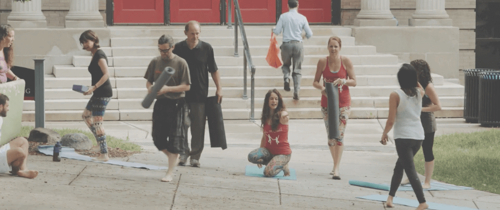 Yoga in front of education building